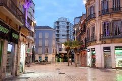 Fyrkant i Malaga på skymning Arkivfoton