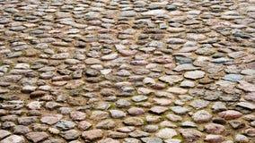Fyrkant som stenläggas med stora stenar för bakgrund och texturer Arkivbilder