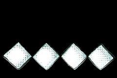 Fyrkanter med vitt ljus på svart Arkivfoton