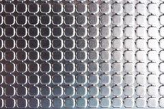 Fyrkanter på skinande metallyttersida Royaltyfria Bilder