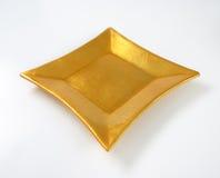 Fyrkantig guld- platta arkivbild
