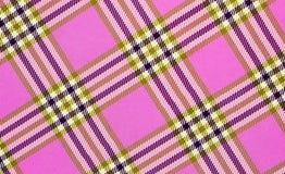 Fyrkantig modellabstrakt begrepptextur med band på rosa bakgrund royaltyfria foton