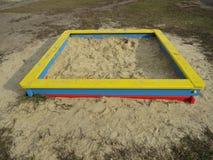 Fyrkantig sandlåda Arkivfoto