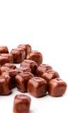 Fyrkantiga rån som täckas med choklad Fotografering för Bildbyråer