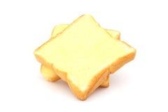 Fyrkantigt bröd med smör Arkivbild