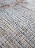 Fyrkantigt nätverk av gammal matta Royaltyfri Bild