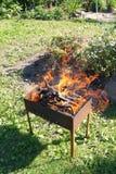 Fyrpanna i brand arkivfoton
