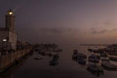 Fyrsolnedgång i Manfredonia - Gargano Arkivfoto
