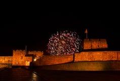 Fyrverkerier över det Carlisle slottet Arkivbilder