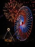 Fyrverkerier och Ferris Wheel Royaltyfri Foto