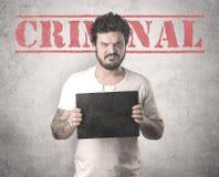 Gángster cogido en cárcel fotografía de archivo