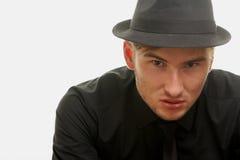 Gángster en un sombrero isolatted en blanco Foto de archivo libre de regalías