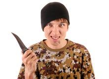 Gángster joven con un cuchillo Imagenes de archivo