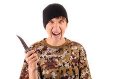 Gángster joven con un cuchillo Fotografía de archivo libre de regalías