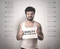 Gângster travado na cadeia foto de stock