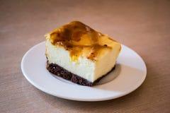 Gâteau au fromage d'un plat Image stock