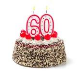 Gâteau avec la bougie brûlante numéro 60 Images libres de droits