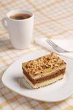 Gâteau avec les écrous et le café Photographie stock