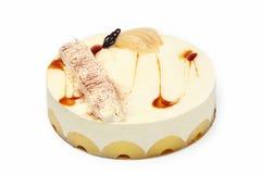 Gâteau crème de poire avec l'ananas sur le fond blanc Photo stock