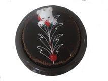 Gâteau de glaçage de chocolat avec l'ours de bougie Images libres de droits