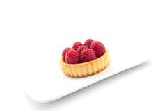 Gâteau de la plaque blanche Photos stock