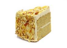 Gâteau de moka d'amande d'isolement sur le blanc Photos libres de droits