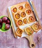 Gâteau de noix de coco et de prune Photographie stock libre de droits
