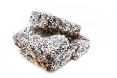Gâteau de noix de coco fait maison de lamington 1 Photos stock