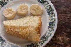 Gâteau et banane Photographie stock