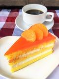 Gâteau et café oranges Image stock