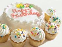 Gâteau et petits gâteaux Image stock