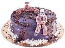 Gâteau fait main noir avec l'ingénieur et l'oléoduc Photographie stock libre de droits