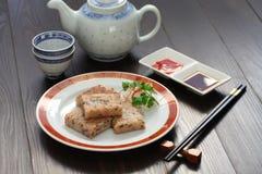 Gâteau fait maison de navet, plat chinois de dim sum Photographie stock libre de droits