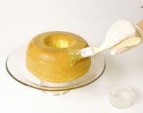 Gâteau glaçant Photos libres de droits
