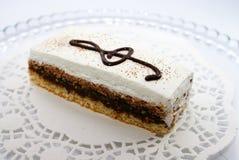 Gâteau avec la clef triple Photo stock