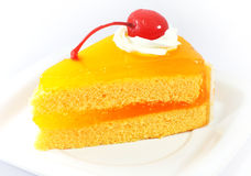 Gâteau orange avec la cerise photos stock