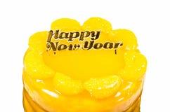 Gâteau orange avec le texte d'or de bonne année Image stock