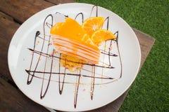 Gâteau orange de crêpe Photographie stock libre de droits