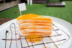 Gâteau orange de crêpe Photographie stock