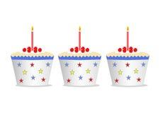 Gâteaux avec des bougies Photos libres de droits