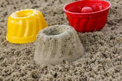 Gâteaux dans le bac à sable photographie stock