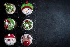 Gâteaux doux de tasse de Noël Photo stock