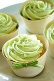 Gâteaux verts de givrage Image libre de droits