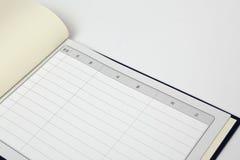Gästbok på vit bakgrund arkivbild