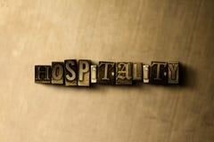 GÄSTFRIHET - närbild av det typsatta ordet för grungy tappning på metallbakgrunden vektor illustrationer