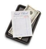 Gästkontroll och pengar Royaltyfri Fotografi