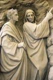 gå ut från helvetesandskulpturer Arkivbilder