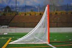 gående lacrosse för bollmål Fotografering för Bildbyråer