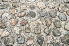 Gångbana med stenen Arkivfoto
