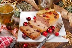 Gåspate med tranbär för jul Arkivfoto